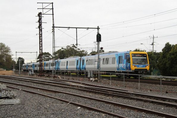 X'Trapolis 917M leads a down Werribee service into Newport