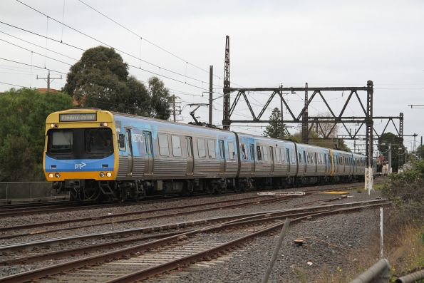 EDI Comeng 504M leads an up Werribee service out of Newport