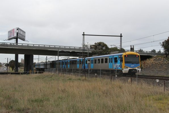 Siemens 787M trails an up Sunbury service outside Ginifer