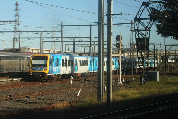 X'Trapolis 115M heads out of service from North Melbourne bound for the high level lines towards Kensington