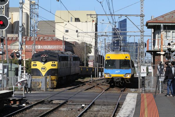 Alstom Comeng on a down Craigieburn service passes S317 and S302 stabled at Kensington