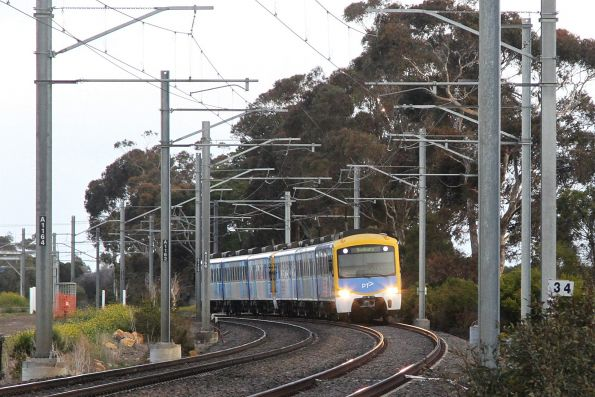 Siemens train departs Diggers Rest on a down Sunbury service