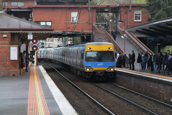 Alstom Comeng arrives into North Melbourne on the up