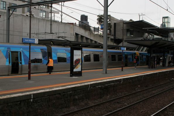 Station staff empty out a terminating train at North Melbourne platform 2