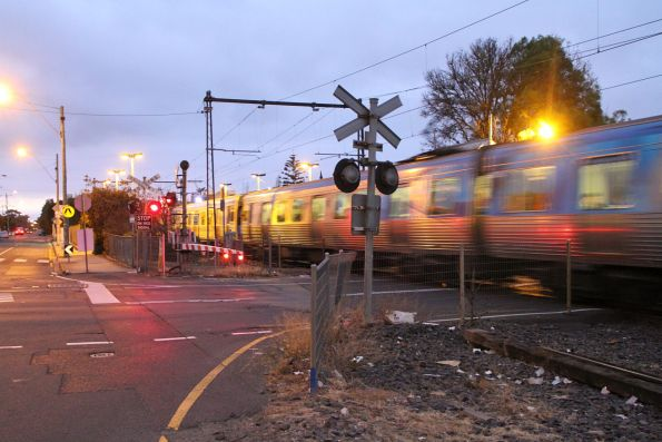 Down Comeng train passes Spotswood