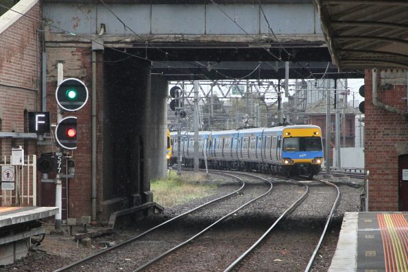 Alstom Comeng 419M arrives into North Melbourne on an up Sunbury service