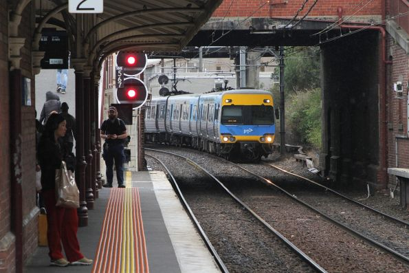 Alstom Comeng arrives into North Melbourne platform 1 on an up service