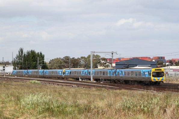 Life extension Comeng 355M leads a down Watergardens service towards Sunshine