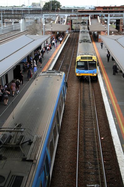 Pair of Comeng trains pass at North Melbourne