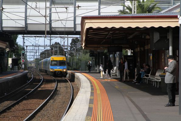 Alstom Comeng train arrives into Footscray on an up Werribee service