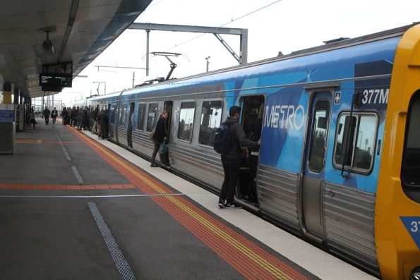 Passengers board life extension EDI Comeng 377M on an up Watergardens service at West Footscray