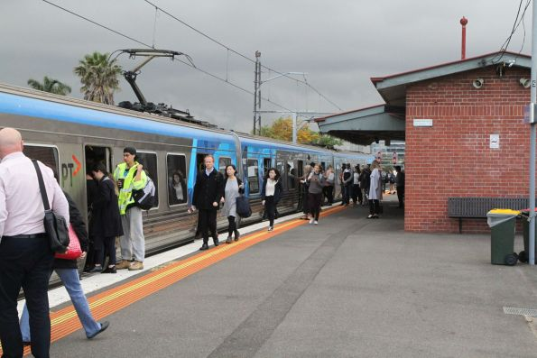 Passengers squeeze onboard a citybound train at Middle Footscray in morning peak
