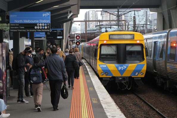 Up Watergardens service departs North Melbourne platform 3 bound for Flinders Street