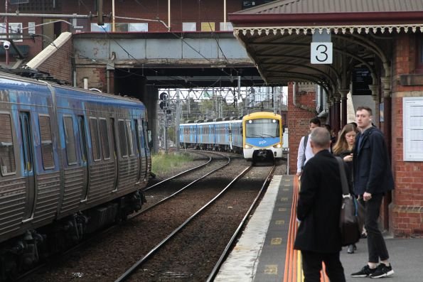 Siemens train approaches North Melbourne platform 3 with an up Sunbury service bound for the City Loop