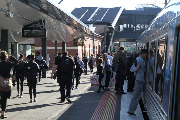 Passengers depart a down Watergardens service at Footscray station