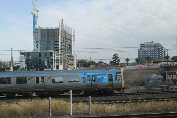 EDI Comeng 545M on a down Werribee service passes apartment developments at Footscray