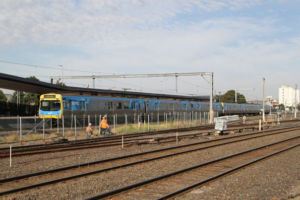 EDI Comeng 548M arrives into West Footscray on the up