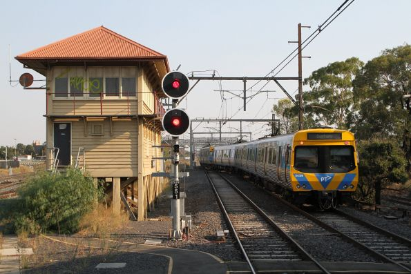 Life extension EDI Comeng 543M traverses the crossover, departing Sunshine platform 1 with a down Sunbury service