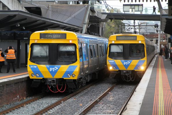 Life extension EDI Comeng trains 317M and 455M pass at North Melbourne