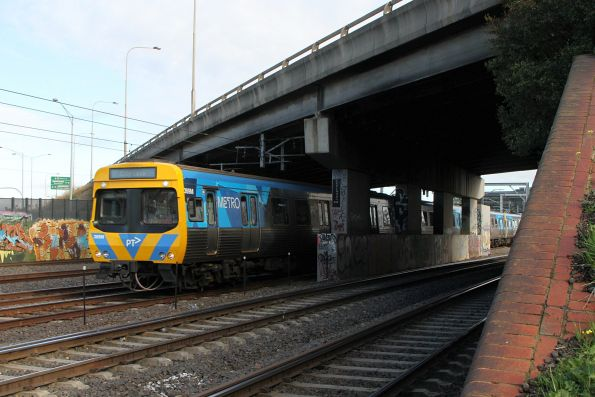 Life extension EDI Comeng 369M leads an up service at West Footscray