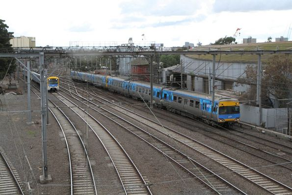 Citybound Siemens and Alstom Comeng trains on the up at North Melbourne Junction