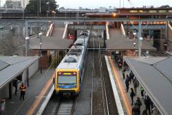 X'Trapolis train departs North Melbourne on a down Werribee service