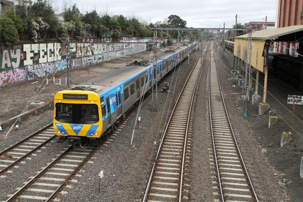 Life extension EDI Comeng 458M on an up Flinders Street direct service at Kensington