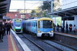 Citybound Siemens train passes Seymour bound VLocity VL21 at North Melbourne