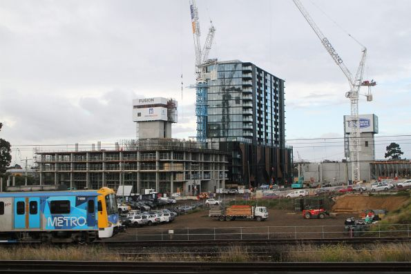 Siemens 749M passes new apartment developments at Footscray