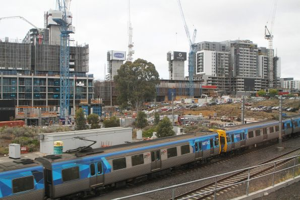 Down Werribee service passes apartment developments at the Joseph Road Precinct in Footscray