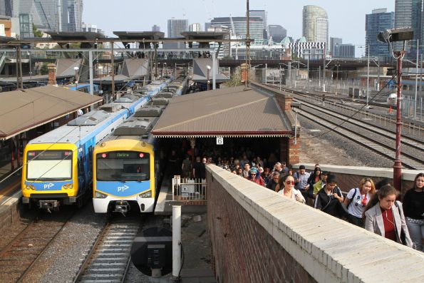 Werribee line passengers exit a Siemens train at North Melbourne platform 6 after it developed a door fault