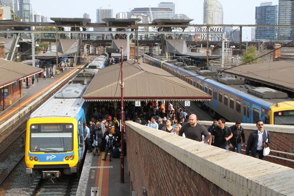 Werribee line passengers heads for an X'Trapolis train at North Melbourne platform 4 after their previous service developed a door fault