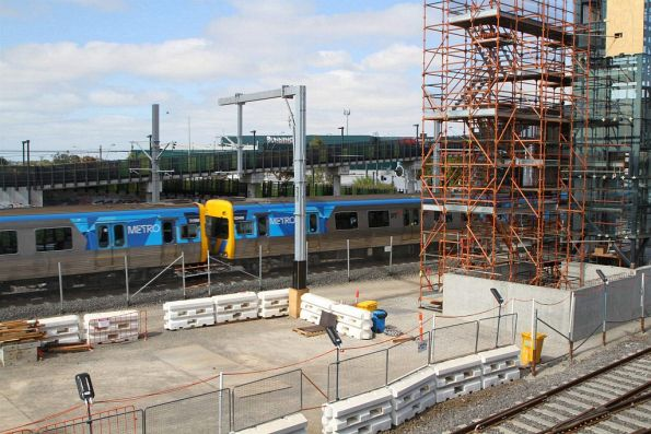Comeng train passes work on the new platform at West Footscray
