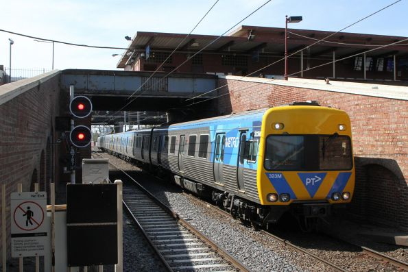 Life extension Alstom Comeng 323M arrives into North Melbourne on the up