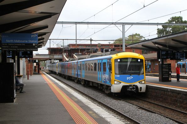 Siemens 713M arrives into North Melbourne on the up