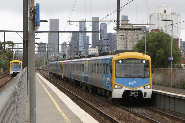Siemens trains on the Werribee and Sunbury lines run parallel through South Kensington