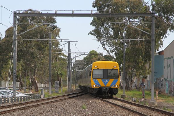 Life extension Alstom Comeng 571M heads onto the double track at Gowrie with an up Upfield service