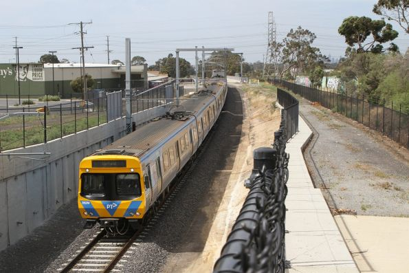Life extension EDI Comeng 382M about to pass under the Camp Road bridge with a down Upfield service