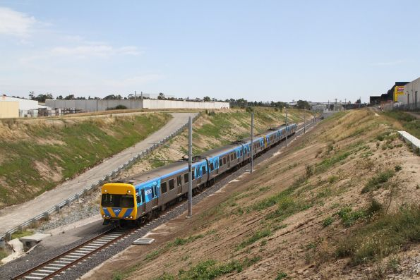 Life extension Alstom Comeng 662M about to pass under the Camp Road bridge with an up Upfield service