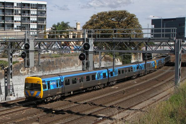 Alstom Comeng 607M on the up at Footscray