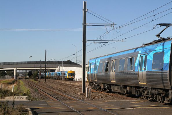 EDI Comeng 522M passes an Alstom Comeng at Aircraft station