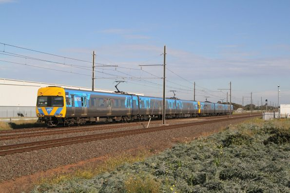 Alstom Comeng 592M trails a down Werribee service at Kororoit Creek Road