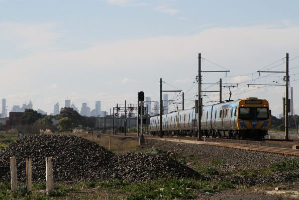 EDI Comeng 497M trails an up Werribee service at Kororoit Creek Road
