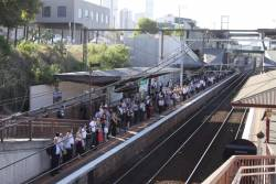 Platform 1 at North Melbourne packed with passengers for the next City Loop bound service