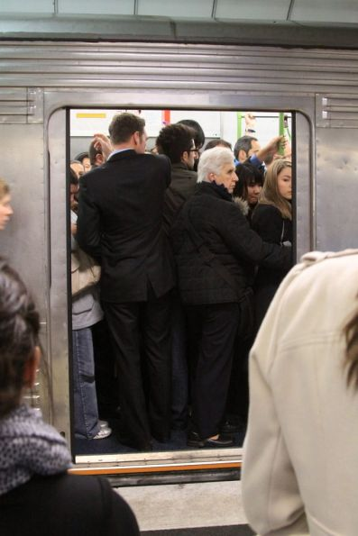 Peak hour crowds pack aboard a Hitachi train