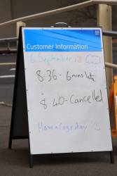 Whiteboard outside the station - one train is 6 minutes late and the next one cancelled
