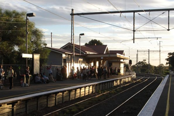 Crowds start to build at Royal Park after the previous Upfield train was altered to run express