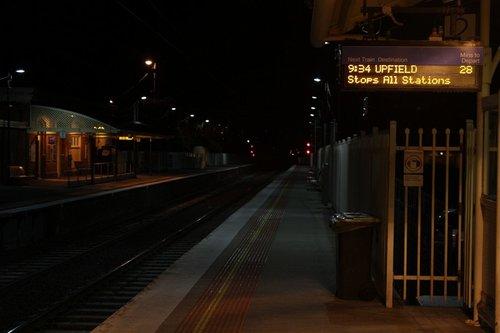 28 minutes until the next Upfield train on a dark platform at Coburg