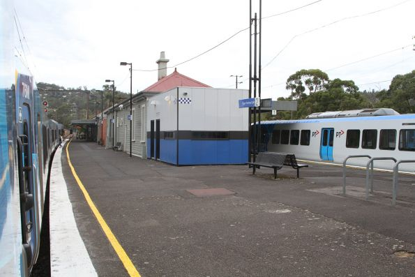 Passengers have to run from one train to the other at Upper Ferntree Gully, after the next citybound service was switched around