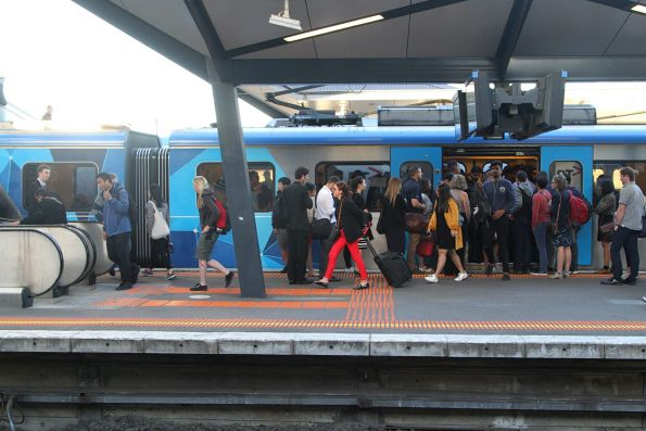 Passengers bank up around the escalators at North Melbourne platform 5
